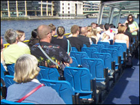 Passengers on the catamaran cruise along the river Thames